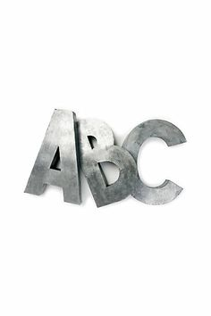 Fun oversized metal letters. You can also search on Etsy to see if you can find vintage letters that add a little more interest than these new ones. Good for not only kids... would be nice to put the first letter of your last name by your front door!