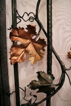 Custom Made Wrought Iron Gates by Paula and Larry Jensen of Earth Eagle Forge LLC, Longville MN   Price range $2,000 - $60,000   Wrought iron gates are custom made for your door entry, driveway, or vineyard. I hand hammer each individual leaf to create artistic detail. I sketch ideas based on your description and personal preferences. Wrought iron gates can be accented with differing metals such as copper to add a colorful dimension.