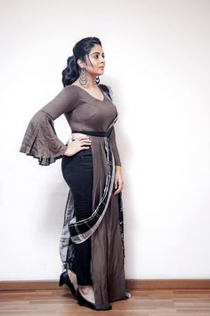 Sreemukhi in a brown color checks saree and pleated bell sleeve blouse design - Indo western style saree Beautiful Girl Indian, Most Beautiful Indian Actress, Beautiful Actresses, Beautiful Women, Sonam Kapoor, Deepika Padukone, Curvy Fashion, Girl Fashion, Bollywood Actress Hot Photos