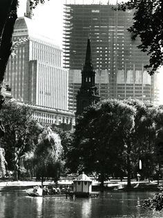 July 12, 1971 : A Swan Boat moved placidly over the Public Garden pond, far removed from the city's hustle and bustle. Construction of the John Hancock Tower can be seen in the background, but it would be five more years until the building was completed.
