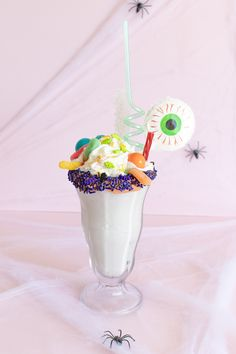Make a fun Halloween freakshake milkshake with holiday sprinkles, gummy worms and other crazy Halloween add-ins to make an over-the-top freakshake!