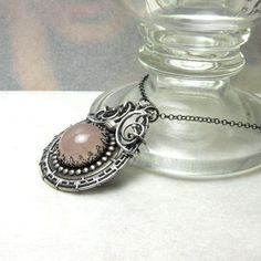 Teegrim  silver wire wrapped pendant with rose by MadeBySunflower