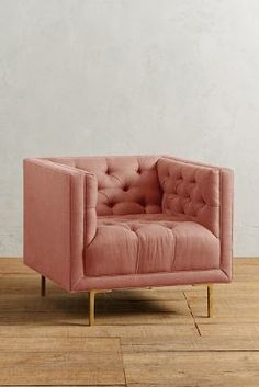 I kind of really want a pink tufted silk chair