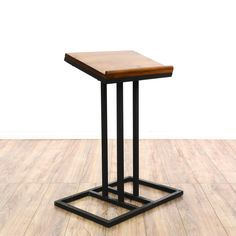 This contemporary lectern podium is featured in a durable metal with a sleek black finish. This bookstand has a solid wood slanted top with a rail edge and pedestal base. Stylish table perfect for practicing speeches! #bohemian #decor #decorativeaccents #sandiegovintage #vintagefurniture