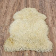 This New Zealand sheepskin is featured in a natural wool with a white ivory tone. This sheepskin is in great condition with unfinished edges and a durable fleece texture. Perfect rug for adding texture to a floor or chair! #contemporary #decor #rug #sandiegovintage #vintagefurniture