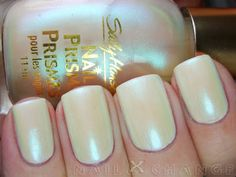 Sally Hansen Nail Prisms South Sea Pearl (swatched once on a nail wheel) $3  This has a delicious teal green shimmer!