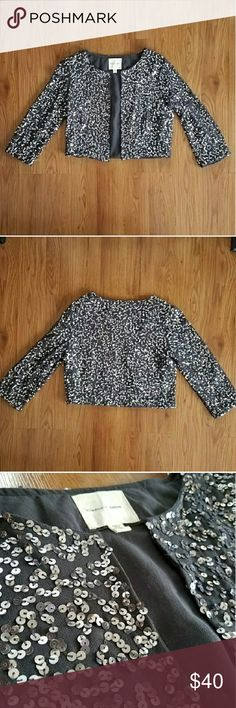 "NWOT silence + noise gray jacket with sequins Gunmetal gray with silver sequins sewn over entire cropped jacket. 3/4 length sleeves.  No closure on this in front, but the light weight fabric lays down nicely. Bust is 34"" Shoulders are 15"" Length is 16"" 100% polyester. Urban Outfitters Jackets & Coats"