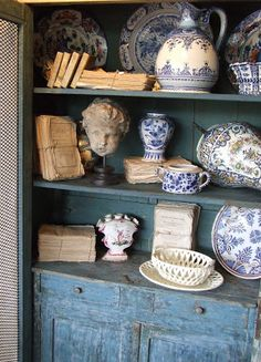 French flea market cupboard with wares photographed by Sharon Santonis, My French Country Home. Blue and white.