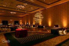 Orlando Wedding DJ - Amber Uplighting with a Customized Monogram at The Wyndham Orlando Resort Burgundy Wedding, Red Wedding, Fall Wedding, Wedding Reception, Wedding Venues, Wedding Ideas, Light Decorations, Wedding Decorations, Uplighting Wedding