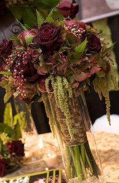burgundy reception wedding flowers, wedding decor, wedding flower centerpiece, wedding flower arrangement, add pic source on comment and we will update it. www.myfloweraffair.com can create this beautiful wedding flower look.