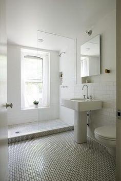 white bath.  mini brick on floor