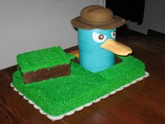 Perry The Platypus White sheet cake with chocolate Perry with gumpaste accents and fondant tail. Phineas And Ferb Perry, Phineas Und Ferb, Fancy Cakes, Cute Cakes, White Sheet Cakes, Fondant, Perry The Platypus, Spy Party, Take The Cake
