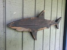 This shark is approximately 20 inches long by 9 inches tall. It is made of recycled fence wood and spray painted with a hand cut stencil for maximum sharkyness. Each piece will be slightly different. Made of the same materials, but each one is hand made and may differ from the others. Each shark also includes a saw tooth hanger for easy hanging.  Each shark will be made to order.  Great outdoors or in. The shark in the picture is not the one youll get. Dont worry. Itll be very similar. Each…
