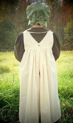 Girls Pioneer Dress with Bonnet and Pinafore size 7-10. $70.00, via Etsy.