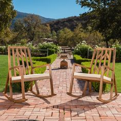 """Monterey Outdoor Wood Rocking Chair with White Cushion (set of 2). Includes: Two (2) Rocking Chairs. Dimensions: 37.75""""D x 26.50""""W x 41.25""""H. Finish: Teak Finish. Easy To Assemble. These acacia wood rocking chairs are sure to be the perfect addition to your patio. The acacia wood body is both great for outdoor furniture as well as beautiful to look at. The cushions are made from a water resistant fabric that helps prolong the life of your outdoor rocking chairs. Overall, these products…"""