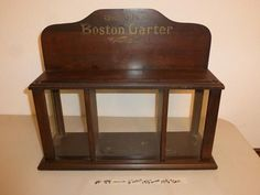Lot #88 - Antique Boston Garter Wood & Glass Display Shelf - Redding Estate Sales - NorCal Online Estate Liquidation Auctions