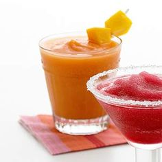 Frozen Strawberry-Mango Margaritas! This frosty drink is a must at summer parties. Made with real fruit!