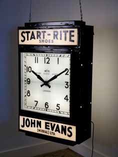 a large double sided illuminated clock black painted steel case with two glass smiths