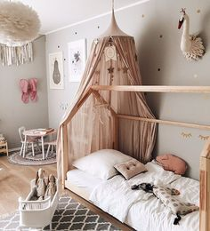 Dove grey walls and blush pink accents in adorable little girls room!