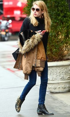Emma Roberts stylishly battled the cold in a black sweater, parka jacket and studded boots