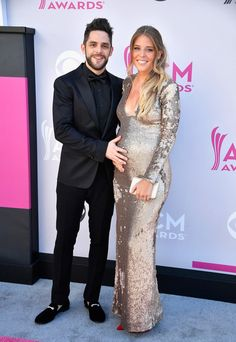 Thomas Rhett Photos Photos - Recording artist Thomas Rhett (L) and Lauren Gregory Akins attend the 52nd Academy Of Country Music Awards at Toshiba Plaza on April 2, 2017 in Las Vegas, Nevada. - 52nd Academy of Country Music Awards - Arrivals