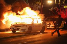 In flames: The confrontation was the night after these scenes of destruction in the suburb of St Louis, Missouri, which came after the acquittal of Darren Wilson over the killing of Michael Brown Ferguson Riot, Ferguson Protest, Darren Wilson, Black Teenagers, Gil Scott Heron, Paradise City, Grand Jury, Michael Brown, Powerful Images