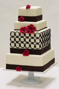 Four tier 1930's inspired brown and white wedding cake decorated with art deco circle elements