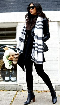 Kayla Seah's oversized black and white scarf looks great worn with a leather coat and skinny jeans. Jacket: Sezane, Top: Cmeo Collective, Jeans: AG, Scarf: Banana Republic, Boots: Ted Baker, Bag: Chloe.