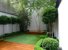 chelsea garden 2015 design low maintenance artificial grass topiary and planting hardwood balau decking
