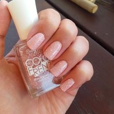 This beautiful mani is created using soft pink nail polish shades with glitter and white flecks. See the wonderful nail products used to DIY easy nail art today.