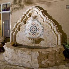 Carved stone wall fountain, Spanish Colonial style home...