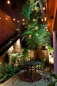 """""""Outdoor lighting doesn't have to look cheap and frilly. When done right, hanging some decorative lighting in your backyard can add a fun style.""""  Chicago Landscape Lighting by Outdoor Accents"""
