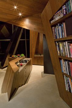 4 of 4: Studio Daniel Libeskind  Connecticut  Inside, the angular oak planes and a change in floor level define the cooking area.
