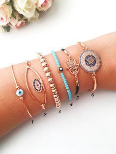 Evil eye bracelet, rose gold bracelet, bangle bracelet, zirconia bracelet, adjustable bracelet, hamsa charm bracelet, miyuki eye bracelet #jewellery #bracelet #zirconiabracelet #banglebracelet #hamsabracelet #evileyemiyuki #rosegoldbracelet #evileyebeaded #roseevileye #evileye #evileyes #hamsahand #bangles