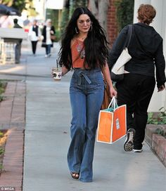 Hippe queen: Vanessa Hudgens, 28, boho chic in a tiny tan-coloured crop top, which she paired with a pair of chic seventies-inspired denims as she stepped out in West Hollywood