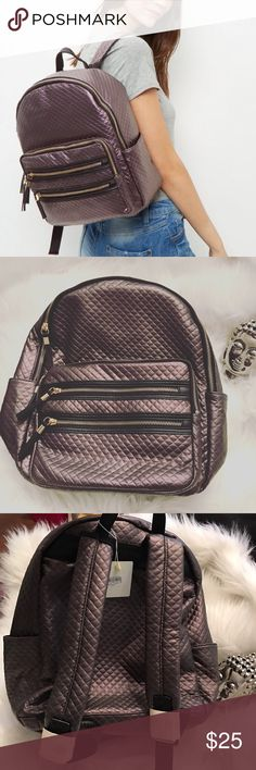 Purple metallic quilted back pack Product Details & Care Product Code: 387399550  - Quilted design - Zip trim - Zip around fastening - Single handle top - Length: 14cm, Height: 35cm, Width: 32cm  Care Guide: Man Made.   Read more at http://www.newlook.com/shop/womens/bags-and-purses/purple-quilted-backpack_387399550#2i0s7s1Y1H84FIbi.99 New Look Bags Backpacks