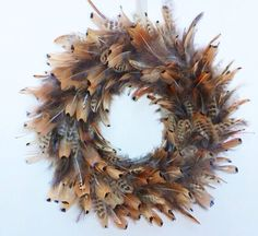 Holiday Wreath made of pheasant feathers - Christmas wreath- Thanksgiving Wreath Christmas Wreaths To Make, Thanksgiving Wreaths, How To Make Wreaths, Holiday Wreaths, Christmas Holidays, Christmas Crack, Classy Christmas, Holiday Decor, Feather Wreath