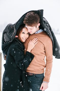 Let your guy show his gallant side by keeping you warm and cozy during a snuggly winter engagement session.   Photography: Kim James Photography - www.kim-james.com  Read More: http://www.stylemepretty.com/canada-weddings/2015/02/26/romantic-whistler-winter-engagement-session/