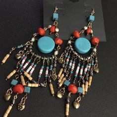 """Fashion earrings Great casual earrings with the look of turquoise, coral with wood and Pearl beads. Really cute! They measure 5"""" long!  New on card. Jewelry Earrings"""
