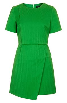 make a statement in a little green dress