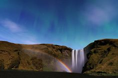 Waterfall, Moonbow, and Aurora from Iceland ---  Image Credit & Copyright: Stephane Vetter (Nuits sacrees)