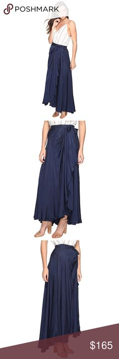 Iris maxi Jetset Diaries Prepare for your next adventure in the Iris Maxi Skirt. Wrap silhouette. Chambray fabrication in a medium blue hue. Inner triple-button closure. Wraparound self ties at waist. Lined. Fluttered hem at a maxi length. 50% polyester, 50% rayon;Lining: 100% rayon. Hand wash cold, line dry. Imported. Measurements: Skirt Length: 40 in Waist Measurement: 26 in Product measurements were taken using size SM. Please note that measurements may vary by size. the jetset diaries…