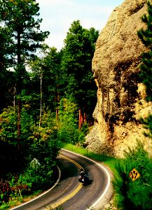 State Route 16A, the Iron Mountain Road, lures riders through the Black Hills, South Dakota. This photo was published in the Great Roads section of Rider magazine in May 2013.