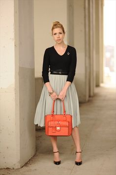 Simple but ballerina-y: Black shirt and full pale green/gray skirt