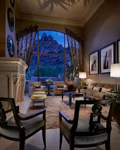 Residential contemporary living room with large arched window