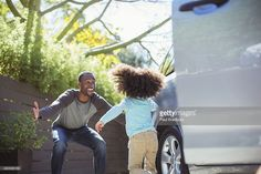 Enthusiastic father greeting daughter outside car