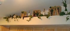 kitchen cabinet decor - wine theme...love the baskets turned on their side