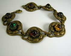 Art Deco Czech Glass Bracelet by worn2perfection on Etsy, $75.00. Find more vintage jewelry like this at Normajeansheirlooms.com
