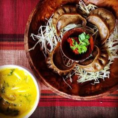 Buckwheat momos filled with pumpkin, lees, and dates cheese served with chili ezay and pumpkin and mushroom tea in Bhutan. Whew! Photo courtesy of timeinthisworld on Instagram.