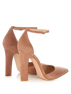 Gianvito Rossi's take on the classic Mary-Jane silhouette is typically elegant. These dusky-pink suede pumps are shaped with a sharply pointed toe and a slender block heel, and secure with a dainty ankle strap. Wear them to ground a floral-print dress at your next garden party.